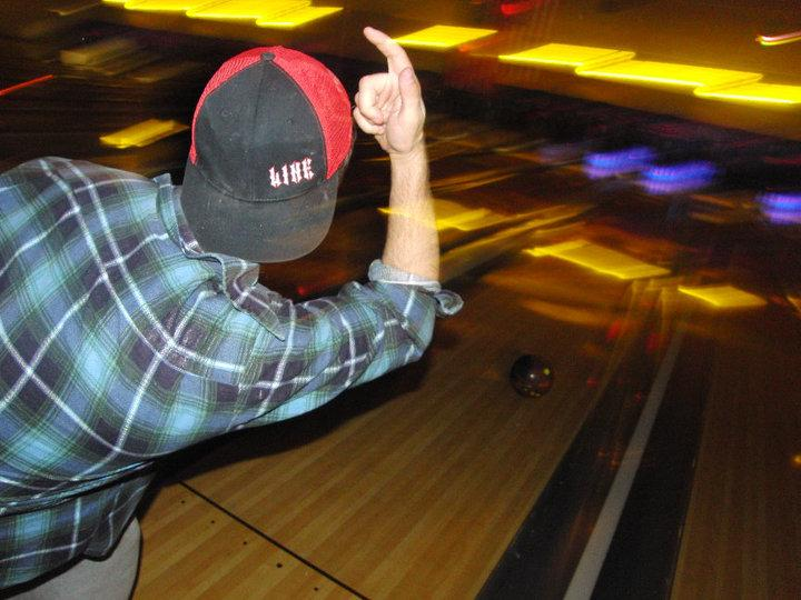 Cory Muscara, '12, a member of Phi Kappa Psi, participates in a school-sponsored bowling mixer with Alpha Chi Omega.