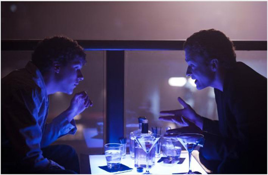 Mark Zuckerberg (Jesse Eisenberg) and Napster founder, Sean Parker (Justin Timberlake) are shown above in a rare moment: face-to-face interaction. Largely, back–stabbing, cold–shouldering and self–isolation take over the fast–paced film. Photo from imdb.com.