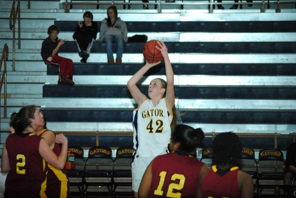 Sophomore Heidi Goeller takes a jumper during Thursday's win over Oberlin. Photo by Charlie Magovern/The Campus