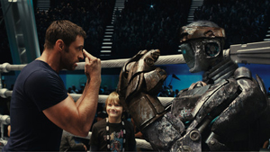 Hugh Jackman plays Charley Kenton, a washed-up boxer who tries to reclaim some glory at the World Robot Boxing championship, in 'Real Steel.' The reviewer was impresssed with the film's use of digital animation. STARPULSE.COM