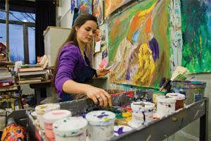 Jacqui Reynolds, '12, works on her compiliation of 40 paintings of various animal species. She expects to spend another $150 on paint and canvas supplies before her comp is finished. CODY MILLER/THE CAMPUS.