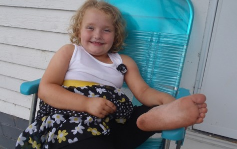 """Alana Thompson, star of TLC's spin-off """"Here Comes Honey Boo Boo,"""" relaxes on her family's porch. Photo courtesy of TLC."""