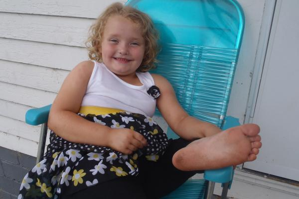 "Alana Thompson, star of TLC's spin-off ""Here Comes Honey Boo Boo,"" relaxes on her family's porch. Photo courtesy of TLC."