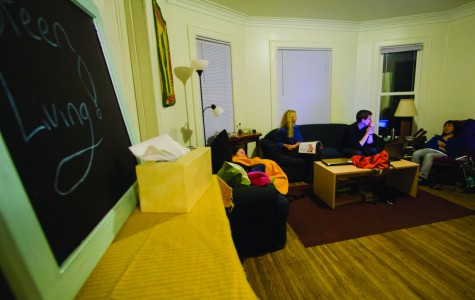 Ava Carvour, '14, Nathan Malachowski, '14 and Tiffany Ng, '14, lounge around the living room of the Green Living House on Loomis Street. CODY MILLER/THE CAMPUS