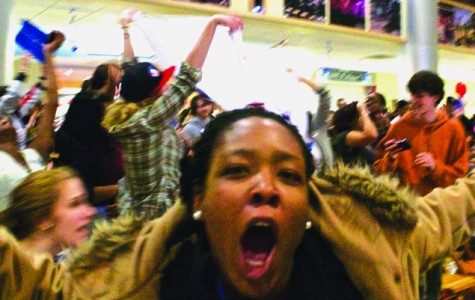 Taisha Thomas, '13, celebrates as President Barack Obama wins a second term. Students gathered in the Campus Center for an Election Day party put on by the Center for Political Participation. CAITIE MCMEKIN/THE CAMPUS