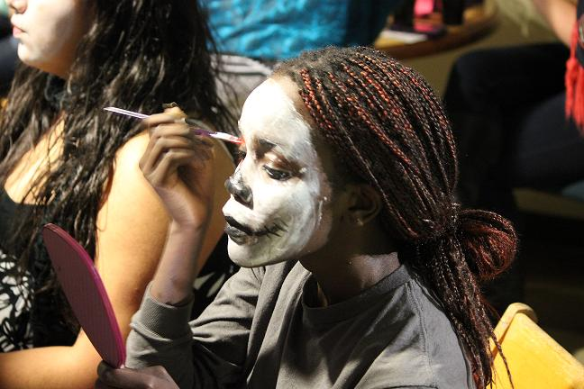 Maya Jones, '15, paints a skull design on her face in celebration of the Mexican holiday Día de los Muertos. Photo credit: Stefano Wach