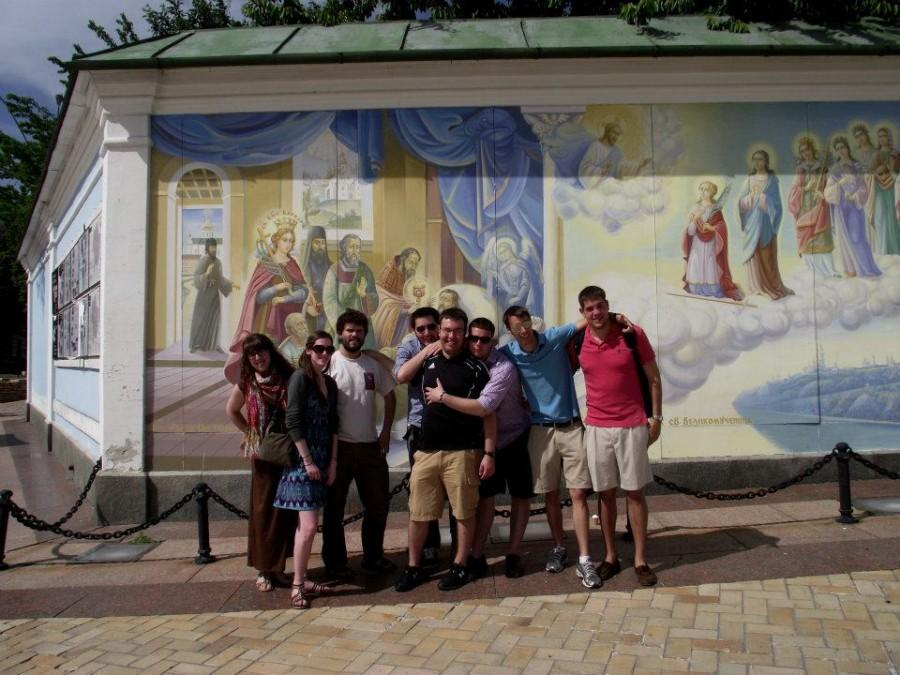 Students stand by a mural in Kiev, Ukraine, during the Days of Kiev celebration on the most recent Experiential Learning trip in summer of 2012. Students from left to right are Morgan Thomas, '14, Sarah Barlow, '13, Lucas Carrion, '13, Kevin Griffin, '13, Marc Hamerski, '13, Aaron Ledbetter, '14, Dan Miller, '13, and John Nelson, '13.
