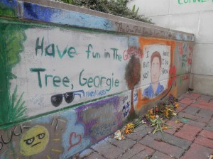"Students decorated ""Gregory's Corner"" with drawings and quotes to remember their beloved friend. Flower offerings were also left next to the mural"