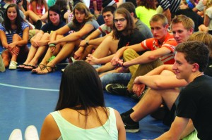 Caitie McMekin/The Campus A group of freshman listen intently to one of their peer's life story. Each freshman had a chance to tell their story at the ALLegheny workshop held on the blue courts in the Wise Center on Aug. 25.