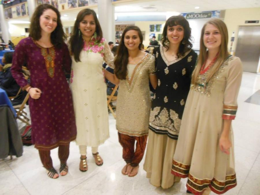 PHOTO BY CHAPLAIN JANE ELLEN NICKEL, DEPARTMENT OF SPIRITUAL AND RELIGIOUS LIFE  From left to right: Haley Lynch, '15, Norreen Chatta, '15, Mikaela pope, '16, Sunniya Nadeem, '16, and Kristen Oravec, '16, pause for a picture during Wednesday's Eid-ul-Adha celebration in the Campus Center.