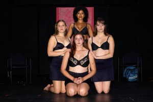 "AUTUMN VOGEL/THE CAMPUS Rachel DuChateau, '16, Alicia Foster, '16, Tori Durst, '15, and Christine McGrath, '17, play the four main characters of the Student Experimental Theater piece ""The Most Massive Women Wins,"" and pose on Arter Theater's stage during the dress rehersal on Oct. 3, 2013. Performances were held on Oct. 4 and 5."