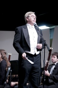 Conductor Lowell Hepler introduces a piece during the Allegheny Wind Symphony concert.  This was his last concert before he leaves for sabbatical next semester.