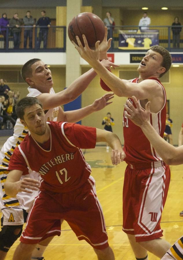 Bobby Theiss, '14, fights for possesion of the ball at the Gator's game against Wittenberg on Sat. Jan. 25, 2014 in the Wise Center. The game ended in a loss for the Gators, 43 to 63 CAITIE McMEKIN/THE CAMPUS