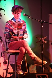 Adam Zahren, '15, participates in the open mic portion of the event where members of the audience were allowed to read their own poetry. MEGHAN HAYMAN/THE CAMPUS