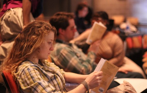 Mary Lyon, '15, reads through her script before a rehersal on Feb. 5, 2014. CAITIE McMEKIN/THE CAMPUS