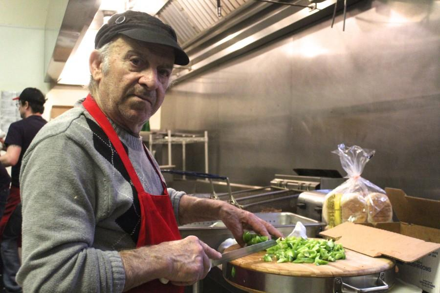 CAITIE McMEKIN/THE CAMPUS Poppa, father of the owner of Mannino's Italian Garden, chops peppers in preperation for a night of cooking Italian dinners for diners at the restaurant on Feb. 20.