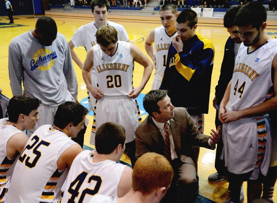 AMASA SMITH/THE CAMPUS Head coach, Jim Driggs, talks strategy with less than a minute left in the game against Denison Sat. Feb. 22, 2014