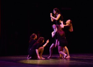 AMASA SMITH/THE CAMPUS From left to right, students Nicole Hohman, '14, Rayna Pelisari, '17, and Caroline Brennan, '17, lift Casey Freed, '15 in one of the JaDE concert dances.