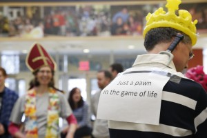 CAITIE McMEKIN/THE CAMPUS Jim Fitch, a staff member in ACCEL, talks strategy with his teammates during the human chess game sponsered by the chess club on Feb. 22, 2014 in the Campus Center lobby. Many of the players were decked out in various chess paraphanalia.