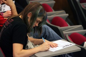 MEGHAN HAYMAN/THE CAMPUS Laura Pellegrini, '17, wrote notes during the discussion on a hand out about the Delhi case on April 9, 2014.