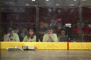 The three judges watch the ongoing battle of two bots. At the end of each battle, judges independently vote for who they believe the winner to be and the majority rules. Nick Ozorak, '13, (right) is an Allegheny Alumnus.