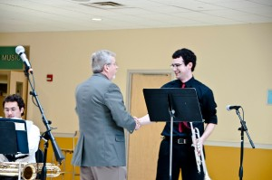 ELLIOTT BARTELS/THE CAMPUS  Daniel Honeycutt, '14, after finishing his solo at the Jazz spring concert.