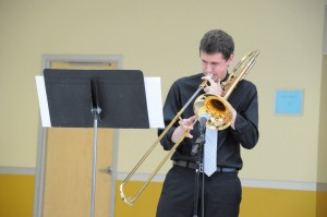 ELLIOTT BARTELS/THE CAMPUS Joe Lampe, '14, performs trombone at the Jazz Band spring concert.