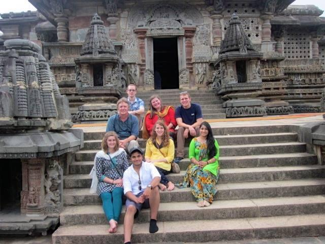 PHOT O COURTESY OF ERICA BRYSON From top, Matthew Turner, '15, Kalyssa King, '15, Garrett Devenney, '16, Professor Juvia Heuchert, Mara Steinmetz, '15, mentor Chandrakala, Erica Bryson, '15 and Abishai Persaud, '15, visit a Hindu temple.