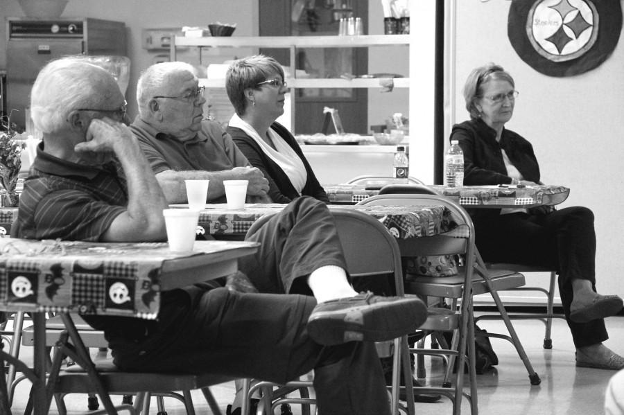 Members of Meadville Senior Center listen to Ronald Cole giving a lecture on hydraulic fracturing.