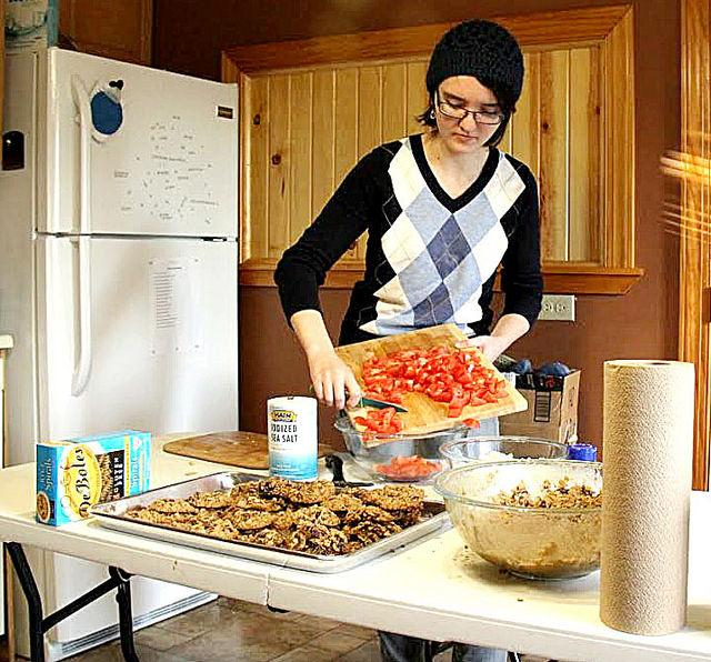 Cara Brosius, '16, is preparing food for the dinner on Friday, Oct. 24 in the Food Co-op House.