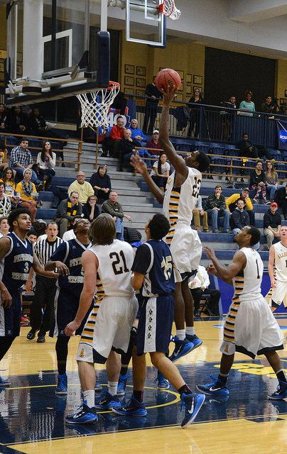 Chris Milon, '16, shoots a basket at the Pitt-Titusville game, which the Gators won 75-45, on Saturday, Nov. 15. The game was part of the Greg Richard's Memorial Tipoff Tournament last weekend. Allegheny men's and women's teams won the tournament and are starting their seasons with 2-0 records.