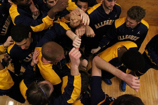 The men huddle to get pumped up before running on to the court for their game against Thiel College on Nov. 22.