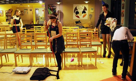 Board members of GFC, including Rachael Robertson, '17, Melissa Mattwig, '17 and Nick Gordon, '15, still wearing their costumes, clean up the coffeehouse after screening the movie Rocky Horror Picture Show on Saturday night, Jan. 31, 2015.