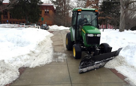 Physical plant continues to clear pathway on Wednesday, Feb. 11 following heavy snowfall the previous week.