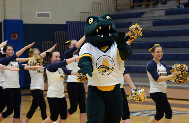 The+cheer+team+%E2%80%98chomps%E2%80%99+alongside+Chompers+after+the+mascot+reveal+following+the+women%E2%80%99s+basketball+game+against+Ohio+Wesleyan+University.+