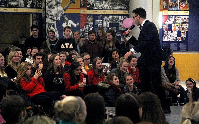Tim Dikec, '16, performs a song for the APO and FIJI's Valentine's Day Auction on Wednsday, Feb. 19. Students who were auctioned offered to do chores including dishes and shoveling snow.    judge photo Jake Ballinger, '16, and and Sukesha Ray, '16, perform together in an effort to earn high bids that would benefit charities