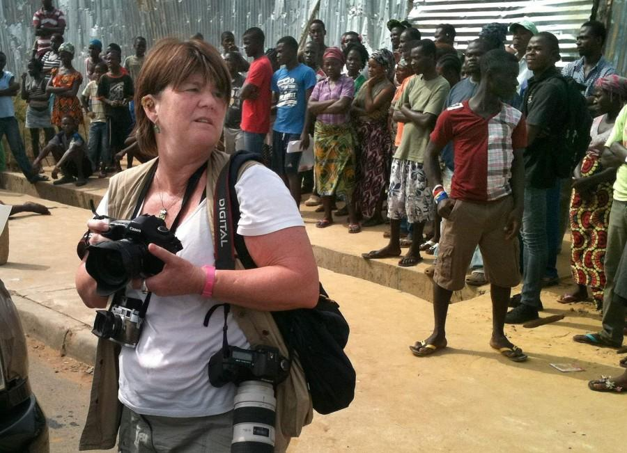 Cheryl Hatch follows the Liberian Red Cross as they picked up dead bodies for transportation to cemetery.