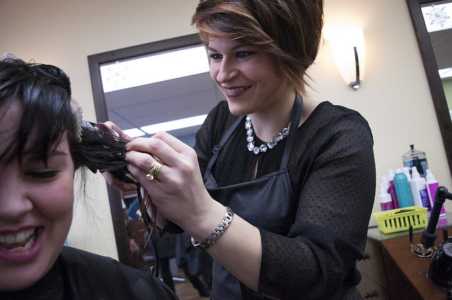 Crystal Ferry starts buzzing Sydney Killburns hair at Cathy's Beauty Salon.