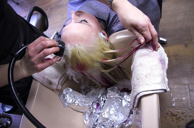 Crystal Ferry rinses Morgan Eakin's hair of pink dye. The 15 year old has been waiting to get the okay from her mom on the drastic hair change.