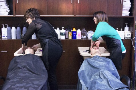 Sydney Killburn and Crystal Ferry wash their client's hair in Cathy's Beauty Salon on a Friday afternoon, March 6th.