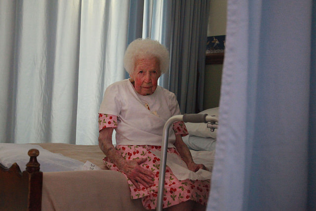 Mary Mahoney, 97, rests on her bed at the Crawford County Care Center.