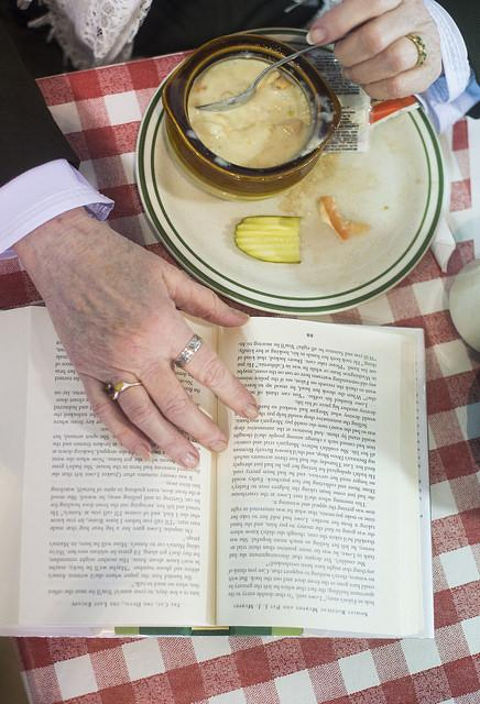 Meadville resident Pat Younkin reads a book while eating soup at the Market House Grille. Younkin said she has been a regular patron since 2005. Photo by Julia Moss.