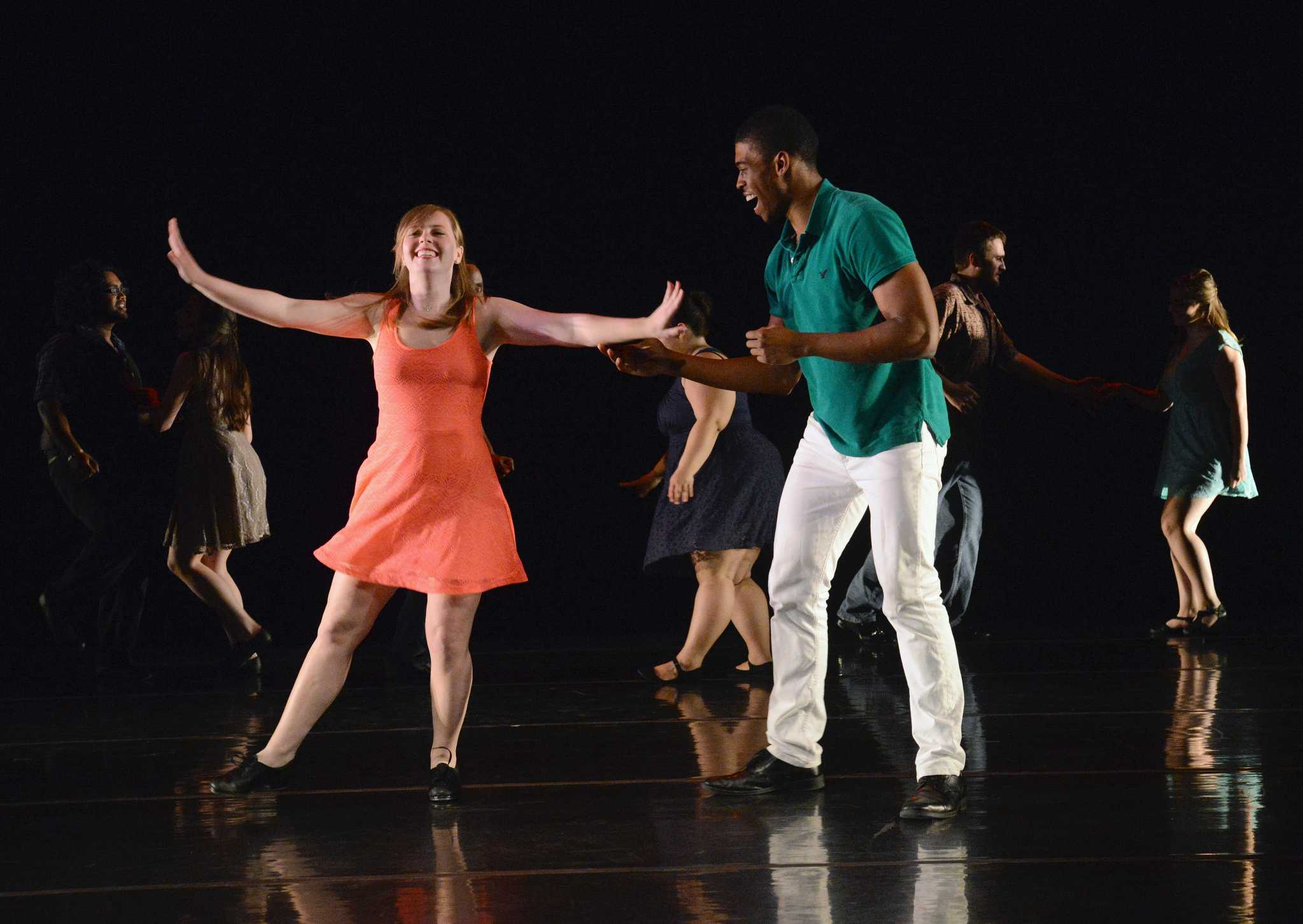 """Autumn Recke, '17, and Akeem Bridgeman, '16, perform in """"Speed Dating"""" on April 9 which is the first of a four-part series choreographed by Betsy Sumerfield. The dance was set to the song """"Swing Set"""" by Jurassic 5."""