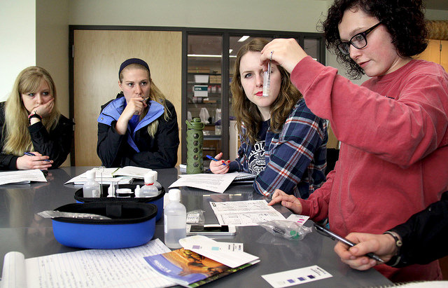 Brea Whiting, '17, right, tests soil properties as Rachael Robertson, '17, Jenny Tompkins, '17, and Paige Hickman, '17, watch in a lab for their Soil to Plate class.