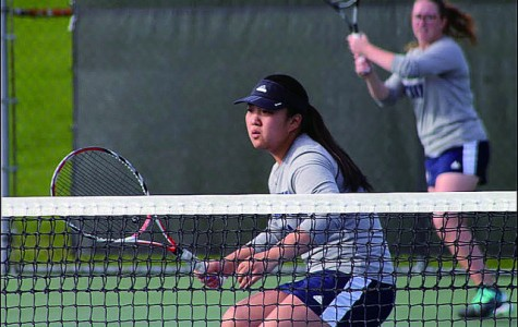 Sun Mo Koo, '16, waits for a volley while partner, Sloane Prince '16, makes a return during the women's tennis match against Westminster Wednesday evening. The team won 9-0, making it three wins in a row.