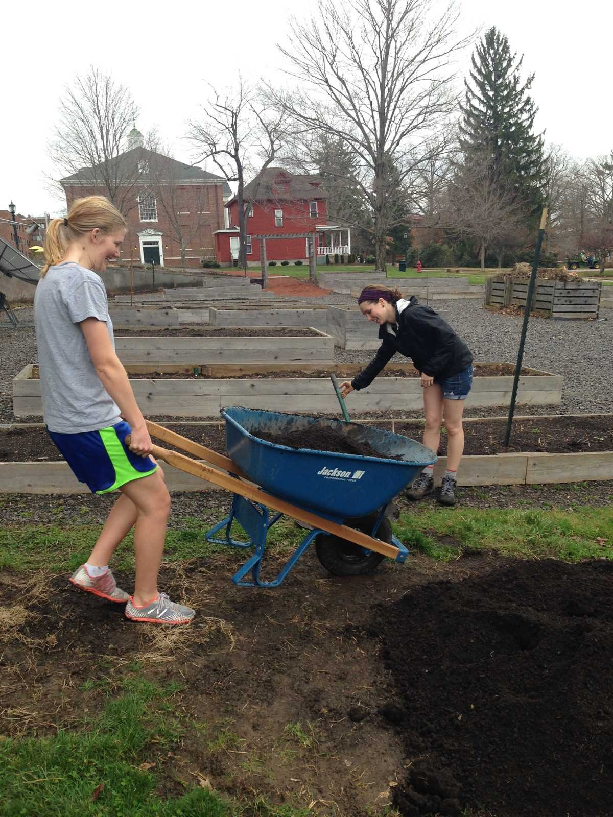 Kelsey Terhune-Cotter, '18, (left) and Kristen Locy, '18, (right) are two of the students who contribute to upkeeping the school garden, otherwise called the Carrden.