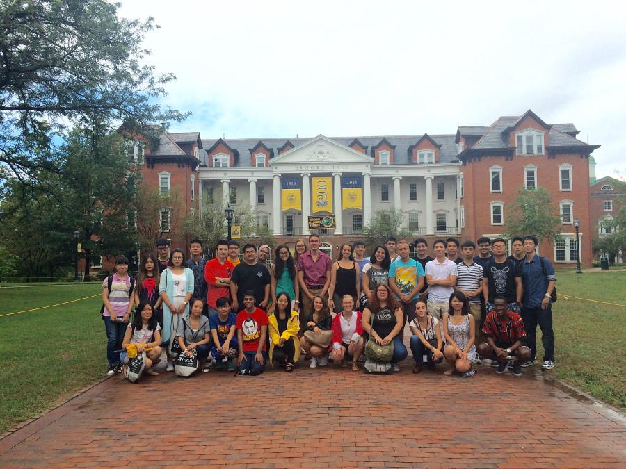 The new international students pose for their first group photo in front of Brooks Hall on Thursday, Aug 20.