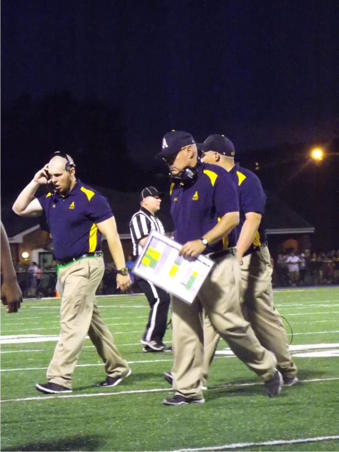 Cody Schultz, defensive line coordinator and Head Coach Mark Matlak walk off the field after a 37-21 Gator loss to Thiel on Saturday, Sept. 5, 2015.