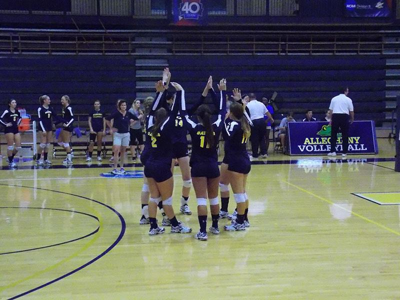 The women's volleyball team gathers during the match against Fredonia on Tuesday, Sept. 1.