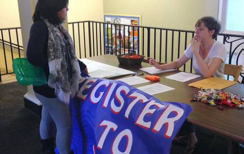 Heather Bosau, '17, tables for the Center for Political Participation to register students to vote on Tuesday, Sept. 22, 2015.